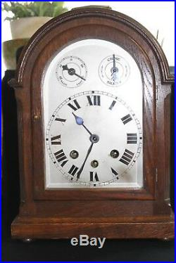 An Edwardian mantle clock with Westminster chimes and silvered dial
