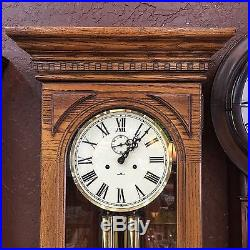 Beautiful Howard Miller Two Spring 2 Weight Westminster Chime Oak Wall Clock