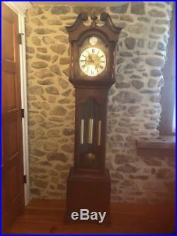 Grandfather Clock by Tempus Fugit in dark cherry cabinet. Solid Brass weights