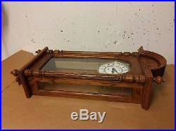 Howard Miller 612-462 Oak Wall 8 Day Clock with Westminster Chimes Key Wound
