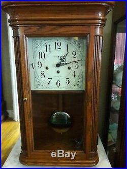 Howard Miller 613-108 Westminster Chimes Wall Clock Oak Key Wound. Retail $1,049