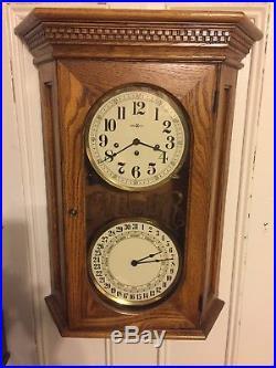 Howard Miller Calendar Clock Westminster Chimes 20x28 Inches Tall 6 Deep