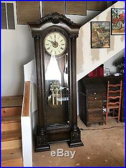 Howard miller grand father clock model 611-008 with Westminster chime