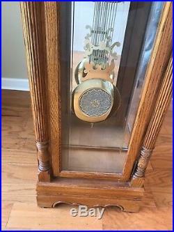 Oak Howard Miller Kenneth Grandfather Clock Model 610-922